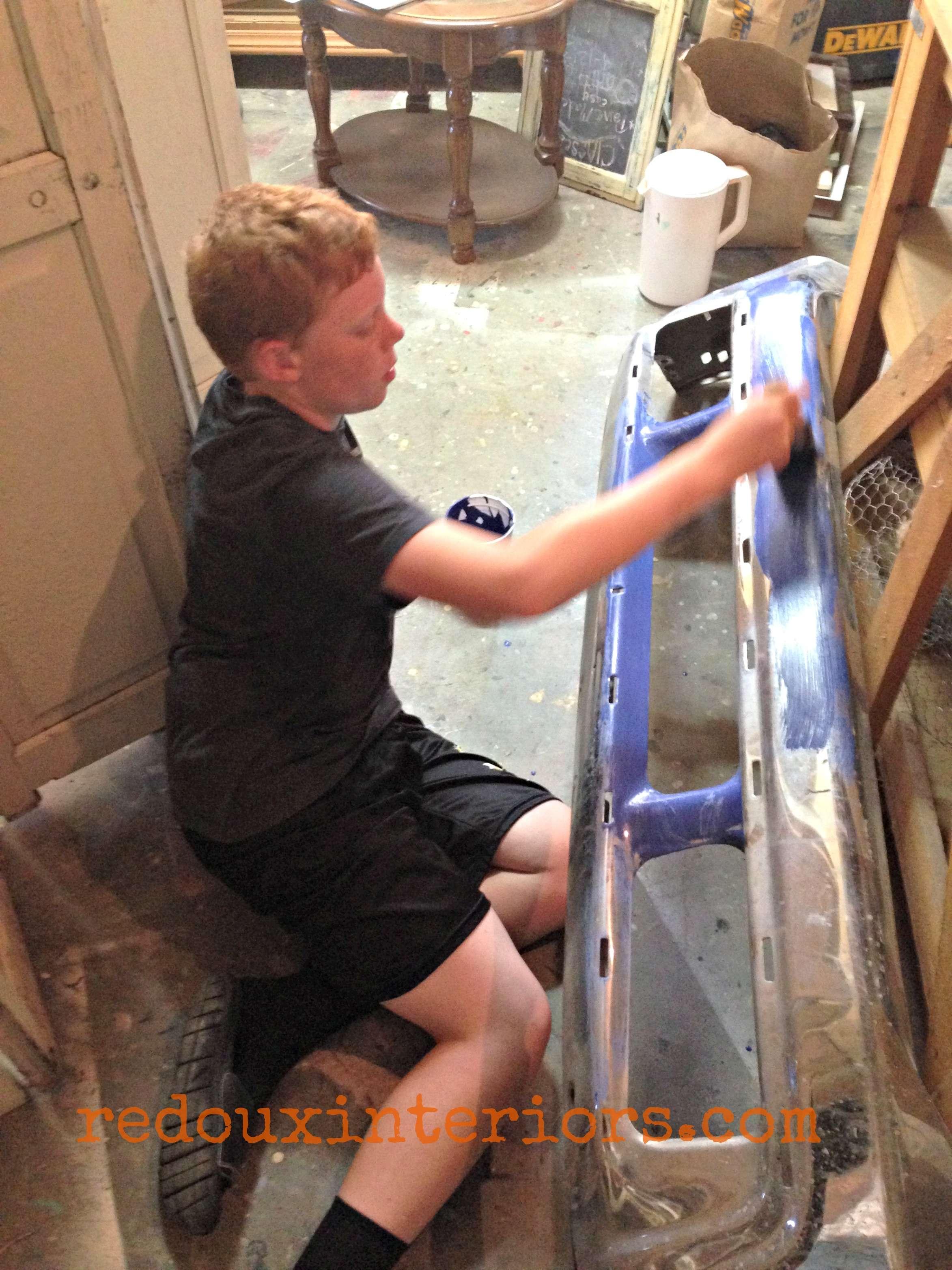Bumper being painted redouxinteriors
