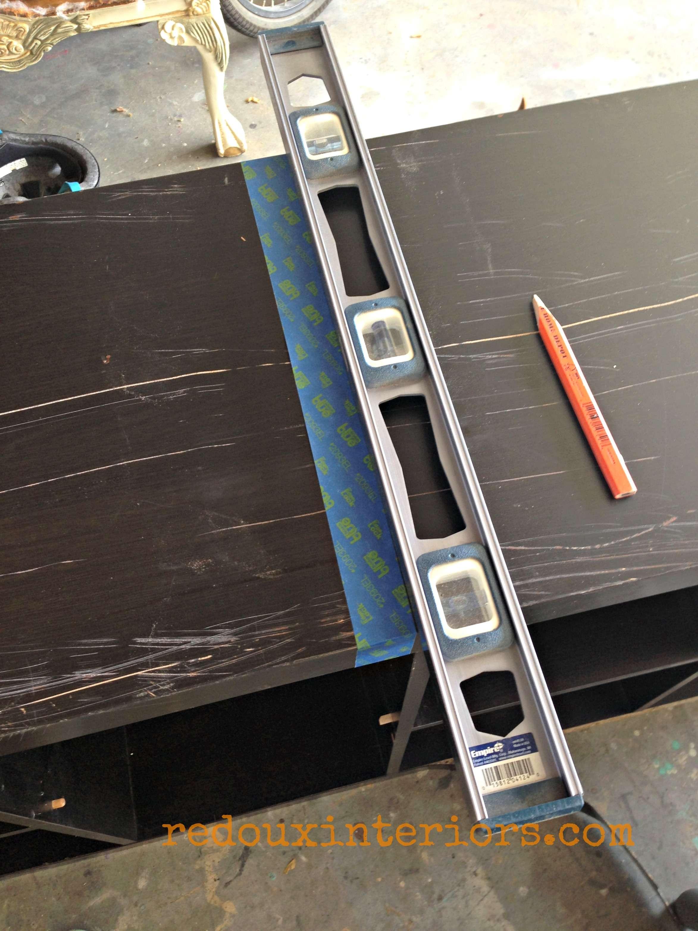 Bookshelf turned cart being measured for cutting redouxinteriors